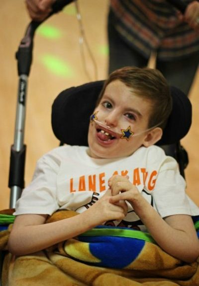 A young boy in a wheelchair